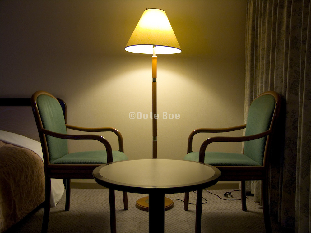 hotel room during the night with two chair facing each other