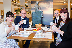 Left to right Cake Artist Rose Dummer, Oak Furniture Land Rotherham Store Manager Jez Groom, Rotherham Hospice Events Fundraiser Ash Corker and Fundraising Team Leader Anne Giblin and  enjoy a Celebration Breakfast with Man of Steel at the opening of the Oak Furniture Land Rotherham Store. The cake will be donated to Rotherham Hospice who will use it to help raise funds<br /> <br /> 3 June 2015<br />  Image &copy; Paul David Drabble <br />  www.pauldaviddrabble.co.uk