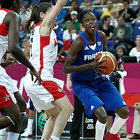 11 August 2012: France Emilie Gomis drives past USA Sue Bird during 86-50 Team USA victory over Team France, during the Women's Gold Medal Game, at the North Greenwich Arena, in London, Great Britain.