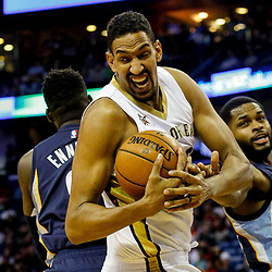 Mar 21, 2017; New Orleans, LA, USA; New Orleans Pelicans center Alexis Ajinca (42) grabs a rebound over Memphis Grizzlies guard Troy Daniels (30) during the second half of a game at the Smoothie King Center. The Pelicans defeated the Grizzlies 95-82. Mandatory Credit: Derick E. Hingle-USA TODAY Sports
