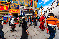 "Tibetan pilgrims circumambulate the route called ""The Barkhor"" around the Jokhang Temple, which is the most sacred in Tibet. Lhasa, Tibet, China."