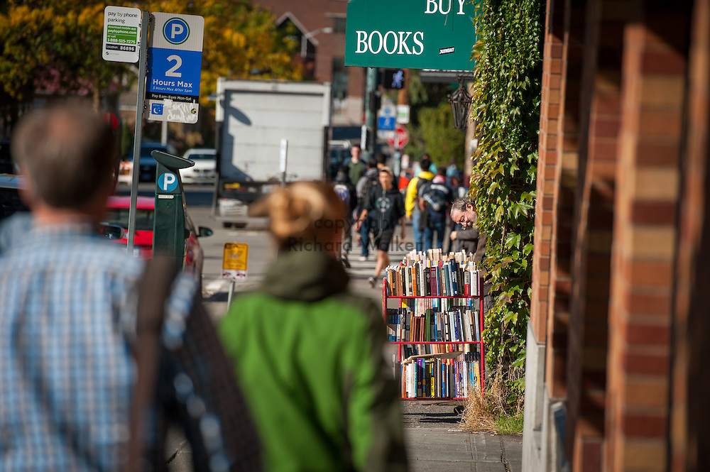 2016 October 11 - Pedestrians and bookstore, University District, Seattle, WA, USA. By Richard Walker