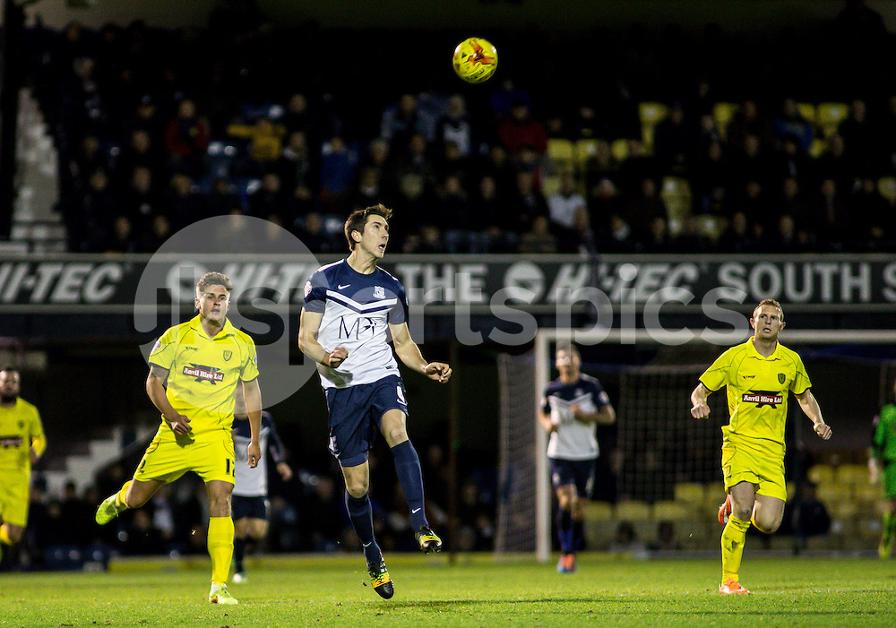 Luke Prosser of Southend Utd heads clear during the Sky Bet League 2 match between Southend United and Burton Albion at Roots Hall, Southend, England on 19 December 2014. Photo by Liam McAvoy.