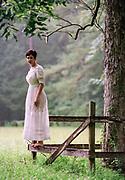 Cindy Vanderhoeven in a sheer white dress on rural home property near Folsom, Louisiana in 1996