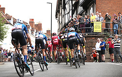 The peloton goes past Westgate, Warwick during stage four of the Ovo Energy Tour of Britain 2018 from Nuneaton to Royal Lemington Spa.