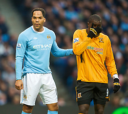 MANCHESTER, ENGLAND - Saturday, November 28, 2009: Manchester City's Joleon Lescott and Hull City's Jozy Altidore during the Premiership match at the City of Manchester Stadium. (Photo by David Rawcliffe/Propaganda)
