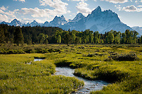 A spring creek flows below the Tetons in Grand Teton National Park, Jackson Hole, Wyoming.