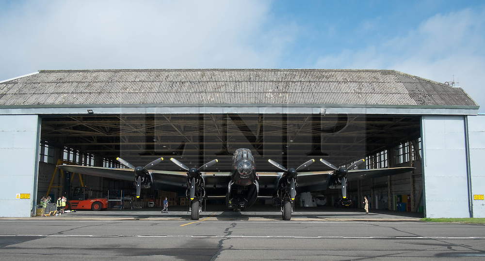 © Licensed to London News Pictures. <br /> 28/08/2014. <br /> <br /> Durham Tees Valley Airport, United Kingdom<br /> <br /> One of only two remaining flying Avro Lancaster bombers is pushed from the hangar as it visits Durham Tees Valley airport today. <br /> <br /> The aircraft, 'Mynarski' is named after Pilot Officer Andrew Mynarski who flew with the Canadian Royal Air Force from the airport which was then called RAF Middleton St George.<br /> <br /> Pilot Officer Mynarski was posthumously awarded a VC after giving his life while trying to save a colleague when their Lancaster was shot down in June 1944.<br /> <br /> The famous World War Two aircraft is owned by the Canadian Warplane Heritage Museum and is beginning a 2-week tour of the UK.<br /> <br /> Photo credit : Ian Forsyth/LNP