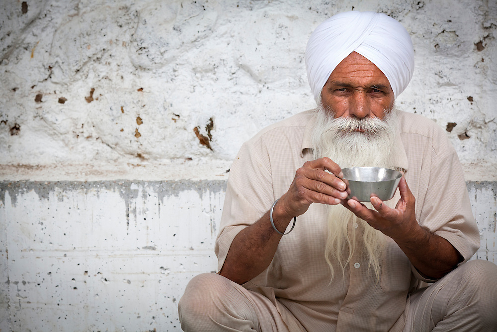 A volunteer in a Sikh kitchen taking a short break.The Sikh kitchen is a part of the Sikh kitchen and provides ten of thousands of free meals on a daily basis.