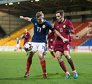 10th November 2017, McDiarmid Park, Perth, Scotland, UEFA Under-21 European Championships Qualifier, Scotland versus Latvia; Scotland's Chris Cadden holds off Latvia's Raivis Jurkovskis