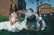 Two girls in Holy communion outfits, Winterbourne Travellers site, Bristol, UK, 1990's