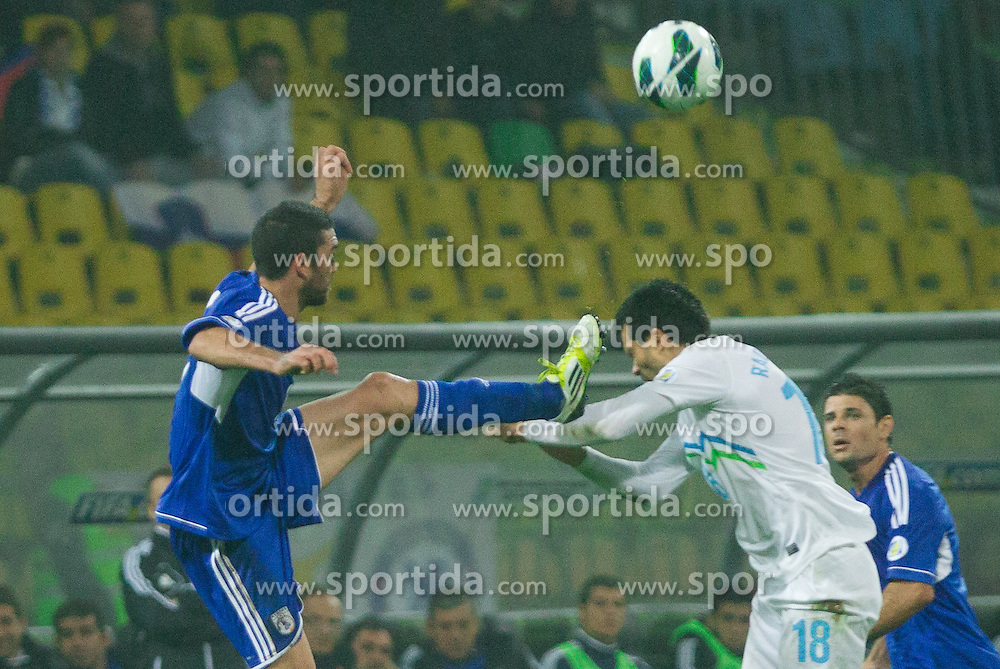 Valentinos Sielis of Cyprus  vs Aleksandar Radosavljevic of Slovenia during football match between National teams of Slovenia and Cyprus in 3rd Round of Group E of FIFA World Cup 2014 Qualification on October 12, 2012 in Stadium Ljudski vrt, Maribor, Slovenia. (Photo By Vid Ponikvar / Sportida)