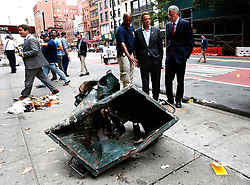 September 18, 2016 - New York, New York, U.S - New York Mayor Bill de Blasio, right, and New York Governor Andrew Cuomo, second right, look over a mangled construction toolbox Sunday, Sept. 18, 2016, while touring the site of an explosion that occurred on Saturday night in the Chelsea neighborhood of New York. Numerous people were injured in blast, and the motive, while reportedly not international terrorism, is still being investigated. (Credit Image: © Prensa Internacional via ZUMA Wire)