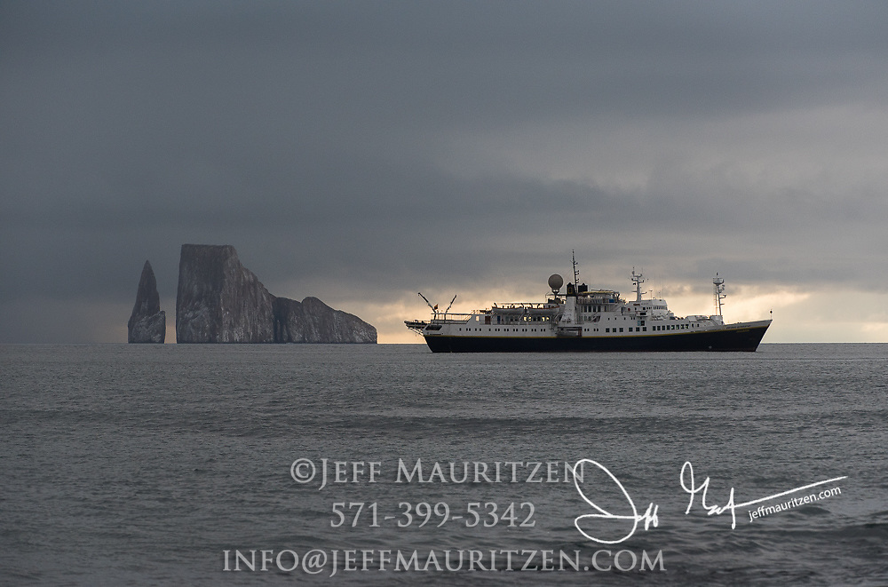 The National Geographic Endeavour anchors off the coast of San Cristobal island near Kicker Rock, Galapagos islands, Ecuador.