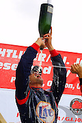 CART race winner Max Papis is doused with champagne while on the podium following the Freightliner/G.I. Joes 200 in Portland.