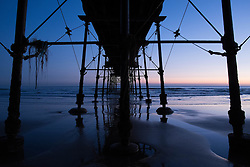 © Licensed to London News Pictures. 12/03/2014<br /> <br /> Saltburn, Cleveland, United Kingdom<br /> <br /> The Victorian pier in Saltburn, Cleveland is bathed in the first light of dawn.<br /> <br /> Photo credit : Ian Forsyth/LNP