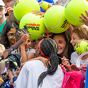 2019 US Open Tennis Tournament- Day Seven.  A smiling Coco Gauff of the United States comforts a distraught young fan caught in the autograph crush after her victory with partner Catherine McNally of the United States in action Nicole Melichar of the United States and Kveta Peschke of the Czech Republic in the Women's doubles round two match on Louis Armstrong Stadium during the 2019 US Open Tennis Tournament at the USTA Billie Jean King National Tennis Center on September 1st, 2019 in Flushing, Queens, New York City.  (Photo by Tim Clayton/Corbis via Getty Images)