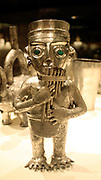 Panpiper Vessel.  Peru: Chimu.  14th-15th century.  Hammered silver, turquoise inlay.  Music was essential to religious and political ceremonies in many ancient American cultures. It was also performed for entertainment and accompanied daily activities such as herding and working in the fields.
