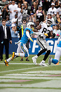Oakland Raiders tight end Jared Cook (87) looks up while trying to catch a pass broken up by Los Angeles Chargers rookie free safety Derwin James (33) during the NFL week 5 regular season football game against the against the Los Angeles Chargers on Sunday, Oct. 7, 2018 in Carson, Calif. The Chargers won the game 26-10. (©Paul Anthony Spinelli)