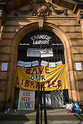 In the final hours before the closure, locals use the facilities of Carnegie Library, Herne Hill, SE24, in the south London borough of Lambeth, which has angered the local community who have occupied their important resouce for learning and social hub. After a long campaign by locals, Lambeth council have gone ahead and closed the library's doors for the last time at 6pm because, they say, cuts to their budget mean millions must be saved. A gym will replace the working library and while some of the 20,000 books on shelves will remain, no librarians will be present to administer it. London borough's budget cuts mean four of its 10 libraries will either close, move or be run by volunteers. Copyright Richard Baker /ALamy Live News