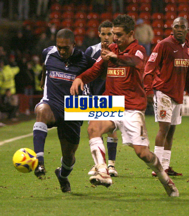 Photo:Mark Stephenson,Walsall fc v Swindon Town.<br />Coca Cola league 2,9-12-2006<br />Swindons Ricky Shakes (L) IS challanged by Walsalls Kris Taylor.