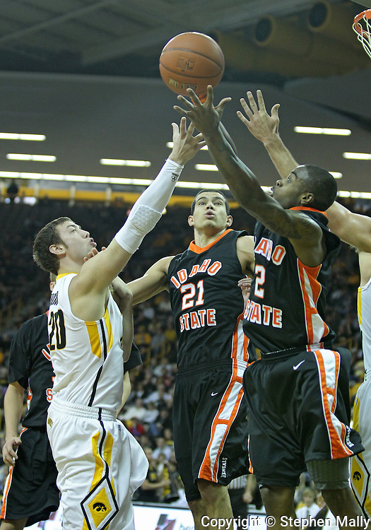 December 04 2010: Iowa Hawkeyes forward Andrew Brommer (20), Idaho State Bengals forward/center Abner Moreira (21), and guard Broderick Gilchrest (2) battle for a rebound during the first half of their NCAA basketball game at Carver-Hawkeye Arena in Iowa City, Iowa on December 4, 2010. Iowa won 70-53.