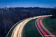 Photo of cars driving below the Francis Scott Key Bridge on the George Washington Memorial Parkway in Arlington Virginia at night.