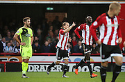 Brentford striker Lasse Vibe celebrating scoring Brentford second goal 2-0 during the Sky Bet Championship match between Brentford and Huddersfield Town at Griffin Park, London, England on 19 December 2015. Photo by Matthew Redman.