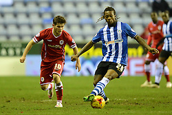 Wigan Athletic's Gaetan Bong competes with Cardiff City's Matthew Kennedy - Photo mandatory by-line: Richard Martin-Roberts/JMP - Mobile: 07966 386802 - 24/02/2015 - SPORT - Football - Wigan - DW Stadium - Wigan Athletic v Cardiff City - Sky Bet Championship