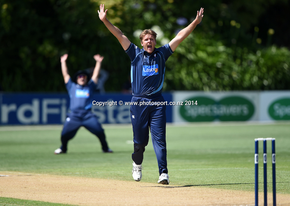 Auckland's Michael Bates appeals successfully for a LBW decision to dismiss James Franklin during the Ford Trophy one day cricket match between Auckland Aces and Wellington Firebirds at the Eden Park Outer Oval, Auckland, New Zealand. Saturday 27 December 2014. Photo: Andrew Cornaga/www.Photosport.co.nz
