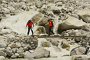Crossing a river, on a bit of a dodgy bridge, while water rushes through rocks on the trek to Everest base camp. Sagarmatha National Park, Nepal.