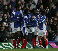 Photo: Lee Earle.<br /> Portsmouth v Tottenham Hotspur. The Barclays Premiership. 01/01/2007. Pompey's Benjani (2ndR) is congratulated after scoring their opening goal.