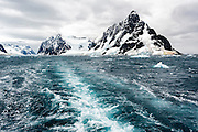 Ships wake leaving the Lemaire Channel, Antarctic Peninsula