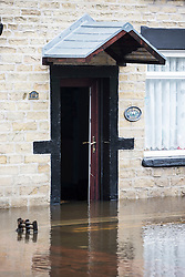 © Licensed to London News Pictures. 22/11/2016. Stalybridge UK. Picture shows two houses that were flooded on Grove road in Stalybridge as Storm Angus hit last night. Photo credit: Andrew McCaren/LNP
