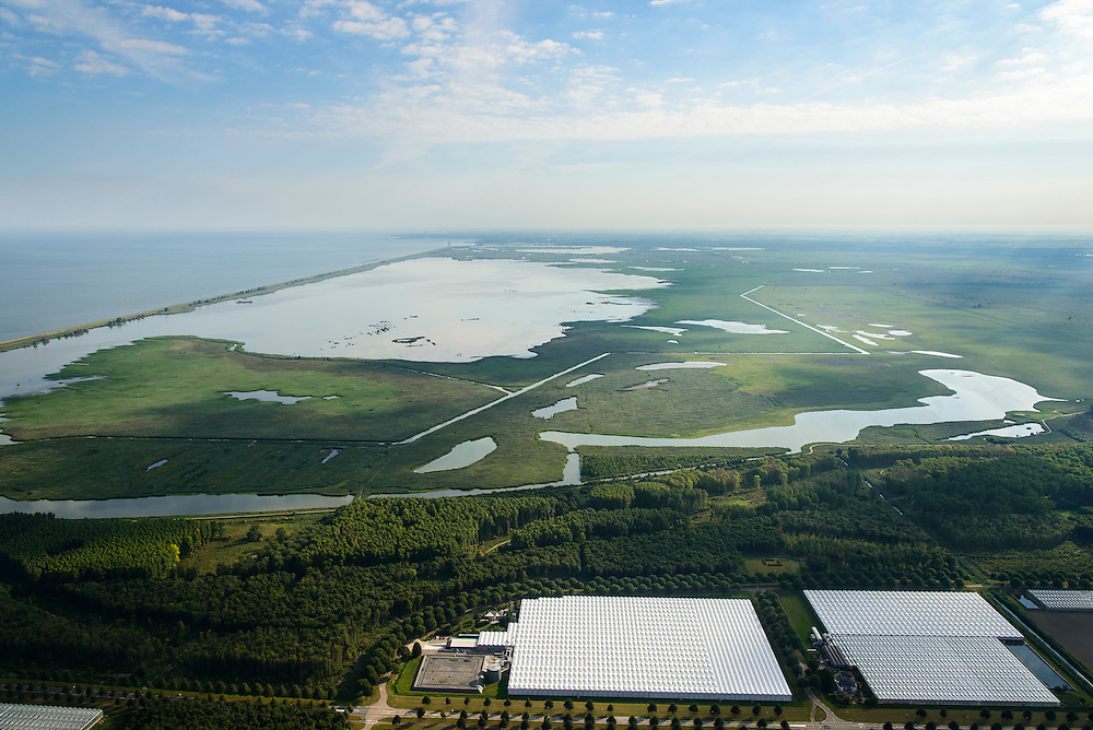 Nederland, Flevoland, Almere, 27-08-2013; Almere-Buiten, glastuinbouwgebied Buitenvaart en Oostvaardersbos. Op het tweede plan de Oostvaardersplassen, gescheiden van het Markermeer door de Oostvaardersdijk.<br /> Greenhouses area north-east of the city of Almere, nature reserve Oostvaardersplassen in the background.<br /> luchtfoto (toeslag op standaard tarieven);<br /> aerial photo (additional fee required);<br /> copyright foto/photo Siebe Swart.