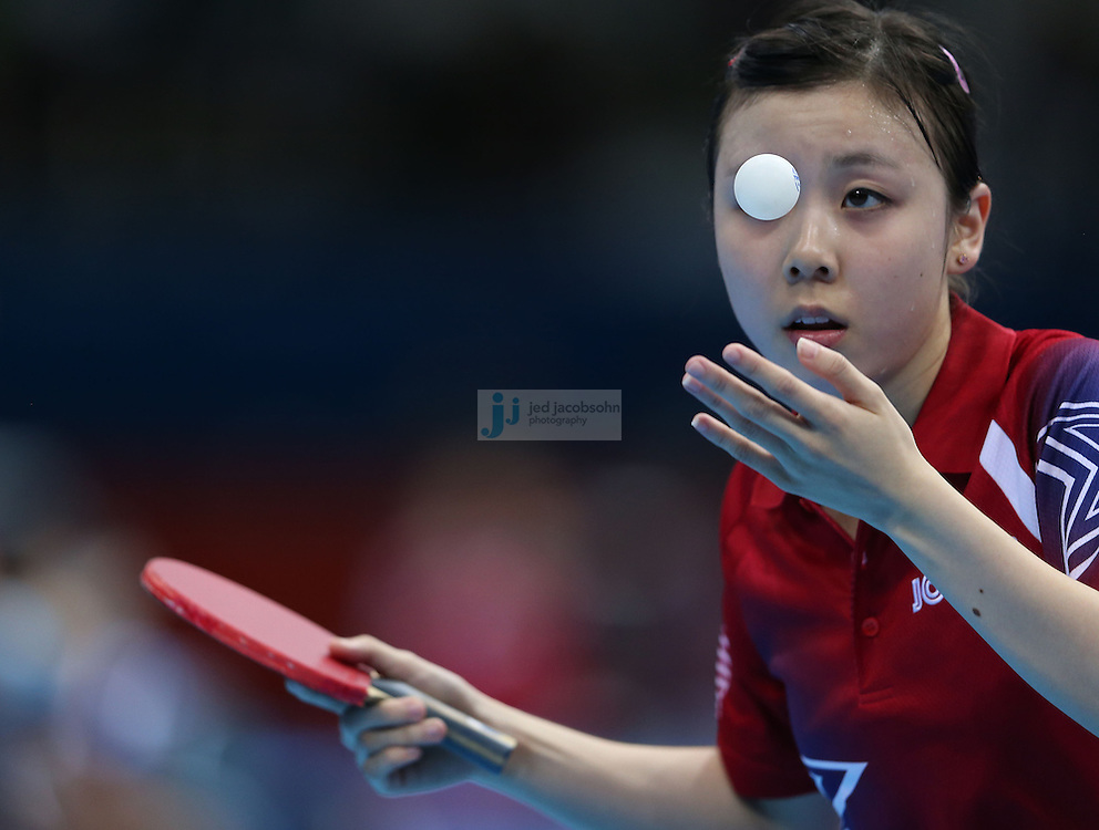 Ariel Hsing of the USA serves against Lain Ni Xia of Luxembourg during a table tennis match at the Olympic Games in London, England, United Kingdom, on 29 Jul 2012..(Jed Jacobsohn/for The New York Times)....