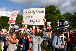 © Licensed to London News Pictures. 03/06/2019. LONDON, UK.  Demonstrators hold up signs during an anti-Donald Trump protest outside Buckingham Palace, on day one of his three day State Visit.  Photo credit: Stephen Chung/LNP