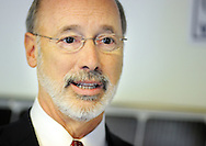 Pennsylvania Governor Tom Wolf speaks with the media after touring Exact Solar's warehouse and calling for the legislature to pass a minimum wage increase Monday April 4, 2016 at the Exact Solar warehouse in Newtown, Pennsylvania. (Photo by William Thomas Cain)