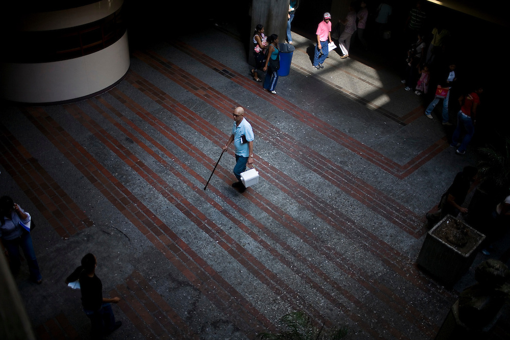 People walk around the lobby of the Domingo Luciani Hospital in Petare, one of the largest and most dangerous slums of Caracas.  Pfizer is trying to increase their market share in the slums and are targeting clinics and hospitals like Domingo Luciani.