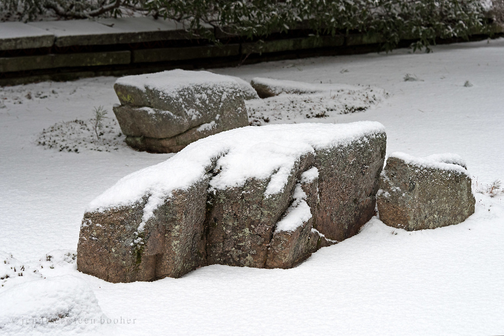Snow-covered stones in the karesansui garden at the Asticou Azalea Garden, Northeast Harbor, Maine.