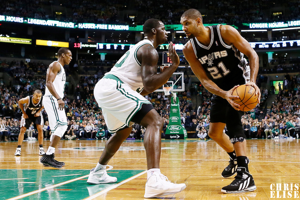 21 November 2012: Boston Celtics power forward Brandon Bass (30) defends on San Antonio Spurs power forward Tim Duncan (21) during the San Antonio Spurs 112-100 victory over the Boston Celtics at the TD Garden, Boston, Massachusetts, USA.