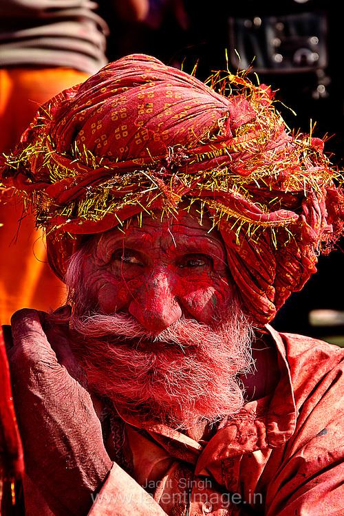 Old man with colorful cap during Holi at Barsana. Braj ki Holi