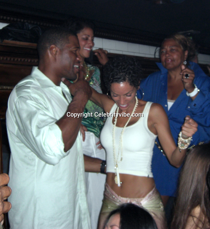**EXCLUSIVE**.Michael Strahan dancing very sexy with girlfriend Nicole Murphy, Eddie Murpy's ex- wife..P. Diddy 4th of July Party.Lily Pond Nightclub.East Hampton, Long Island, USA.Friday, July 04, 2008..Photo By Celebrityvibe.com.To license this image please call (212) 410 5354; ..or Email: celebrityvibe@gmail.com ;.website: www.celebrityvibe.com.