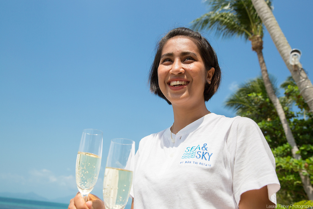 Staff serving refreshments on the lower terrace at Sea and Sky beach front restaurant located on Ban Tai beach, Koh Samui, Thailand