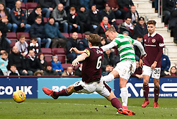 Celtic's Leigh Griffiths shoots for goal as he is tackled by Hearts Christophe Berra during the Ladbrokes Scottish Premiership match at Tynecastle Stadium, Edinburgh. PRESS ASSOCIATION Photo. Picture date: Sunday December 17, 2017. See PA story SOCCER Hearts. Photo credit should read: Ian Rutherford/PA Wire. EDITORIAL USE ONLY