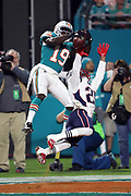 Miami Dolphins wide receiver Jakeem Grant (19) out leaps and catches a 25 yard touchdown pass good for a 20-10 third quarter lead while covered in the end zone by New England Patriots cornerback Malcolm Butler (21) during the 2017 NFL week 14 regular season football game against the New England Patriots, Monday, Dec. 11, 2017 in Miami Gardens, Fla. The Dolphins won the game 27-20. (©Paul Anthony Spinelli)