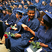 Sue Nelson gets a congratulatory handshade from fellow graduate Michael Wright at their Grandview College graduation in Des Moines, Iowa.  Both were older minority students who finally realized their dream of receiving a college degree.