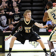 Central Florida forward P.J. Gaynor (21) defends against Augustus Gilchrist (24)  during the NCAA basketball game against the USF Bulls at the UCF Arena on November 18, 2010 in Orlando, Florida. UCF won the game 65-59. (AP Photo/Alex Menendez)