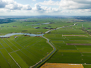 Nederland, Noord-Holland, Gemeente Waterland, 16-04-2012; linksonder de Polder Katwoude, rechts De Purmer. Boven het midden, rond het water van De Leek (Overleek) de Monnikenbroek en Rietbroek. Amsterdam aan de horizon..View on the polder the Purmer and polder Katwoude between several brooks. In the back the the skyline of Amsterdam. .luchtfoto (toeslag), aerial photo (additional fee required);.copyright foto/photo Siebe Swart