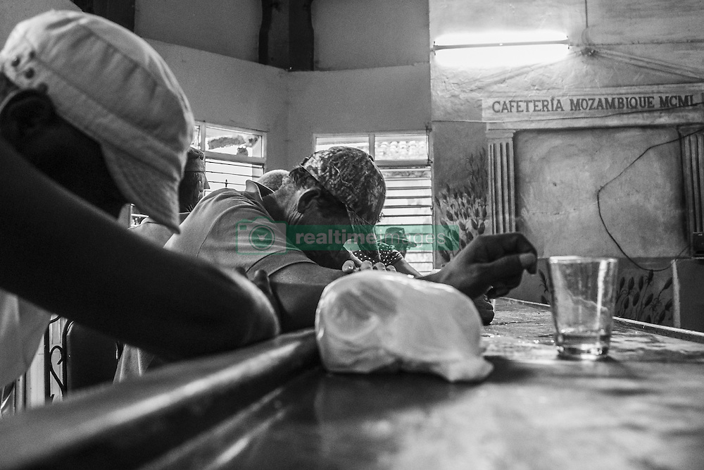 December 10, 2016 - Havana, Cuba - Cuban state´s bars represent the decadence and sordidness of Cuban society, which, in search of life on the black market, find in these dens a place to forget about everything with a sip of rum, to look for some food outside Of the official market, offer their services as a mechanic or earn a few pesos doing whatever is needed. Havana, Cuba, on 10 December 2016. (Credit Image: © Alvaro Fuente/NurPhoto via ZUMA Press)